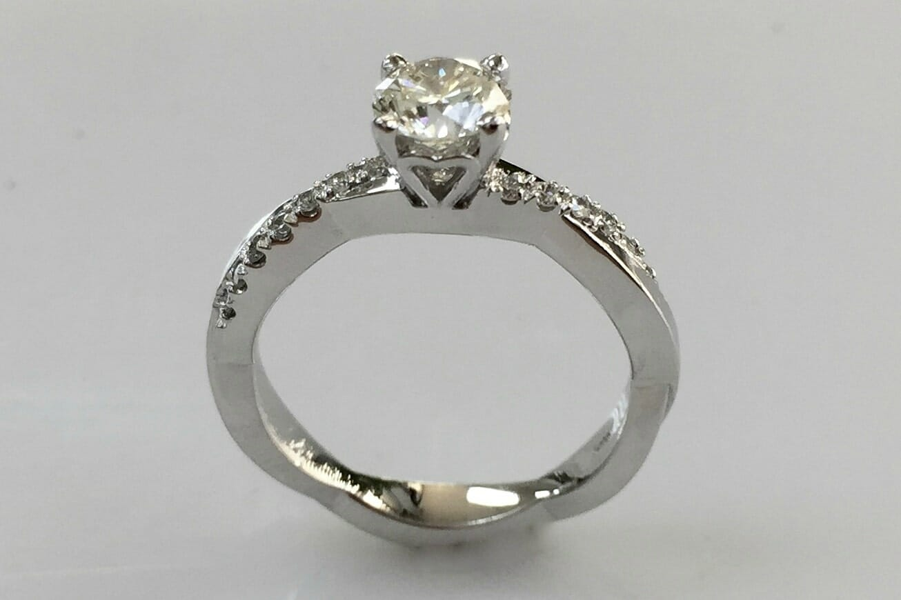 white gold soltaire engagement ring side view
