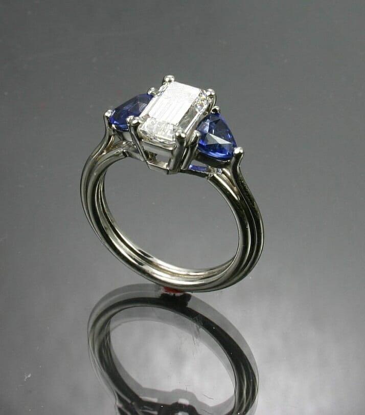 Three Stone Diamond Ring with Sapphire Side Stones