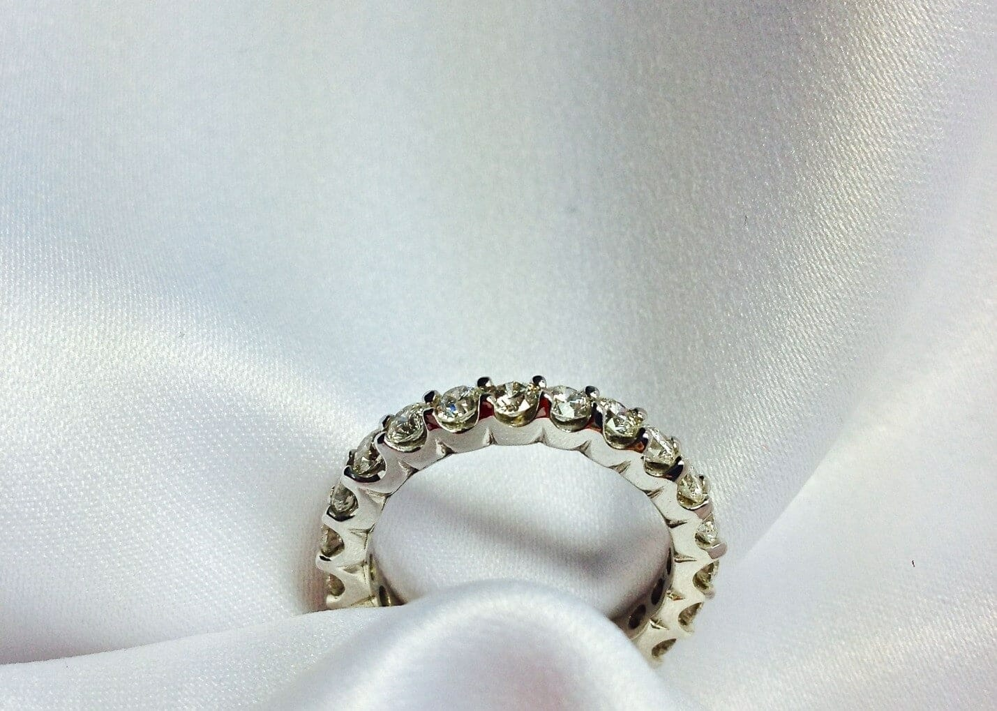 Diamond eternity ring featuring scallop side detail
