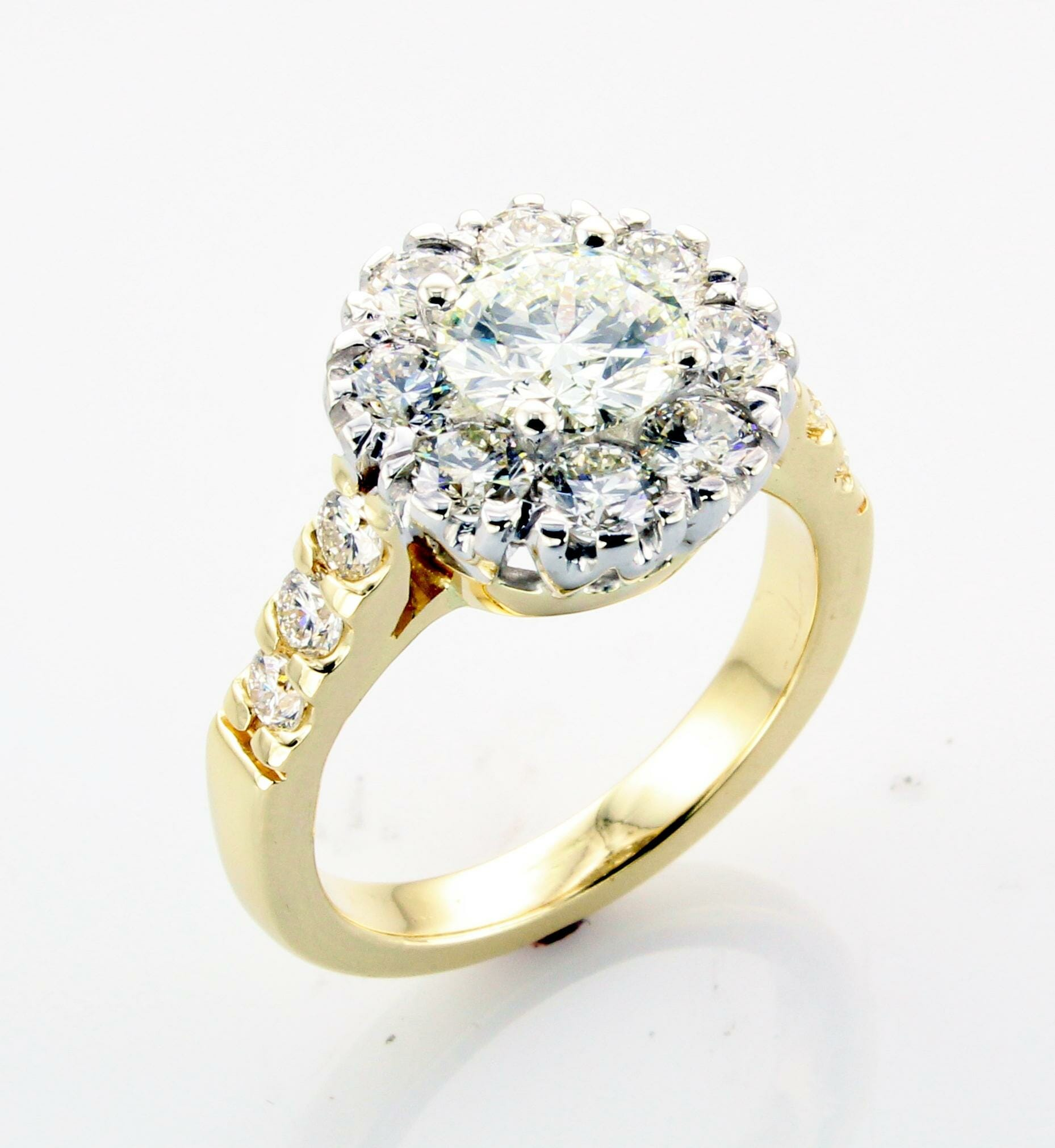 Yellow gold halo diamond engagement ring with side diamonds down shank
