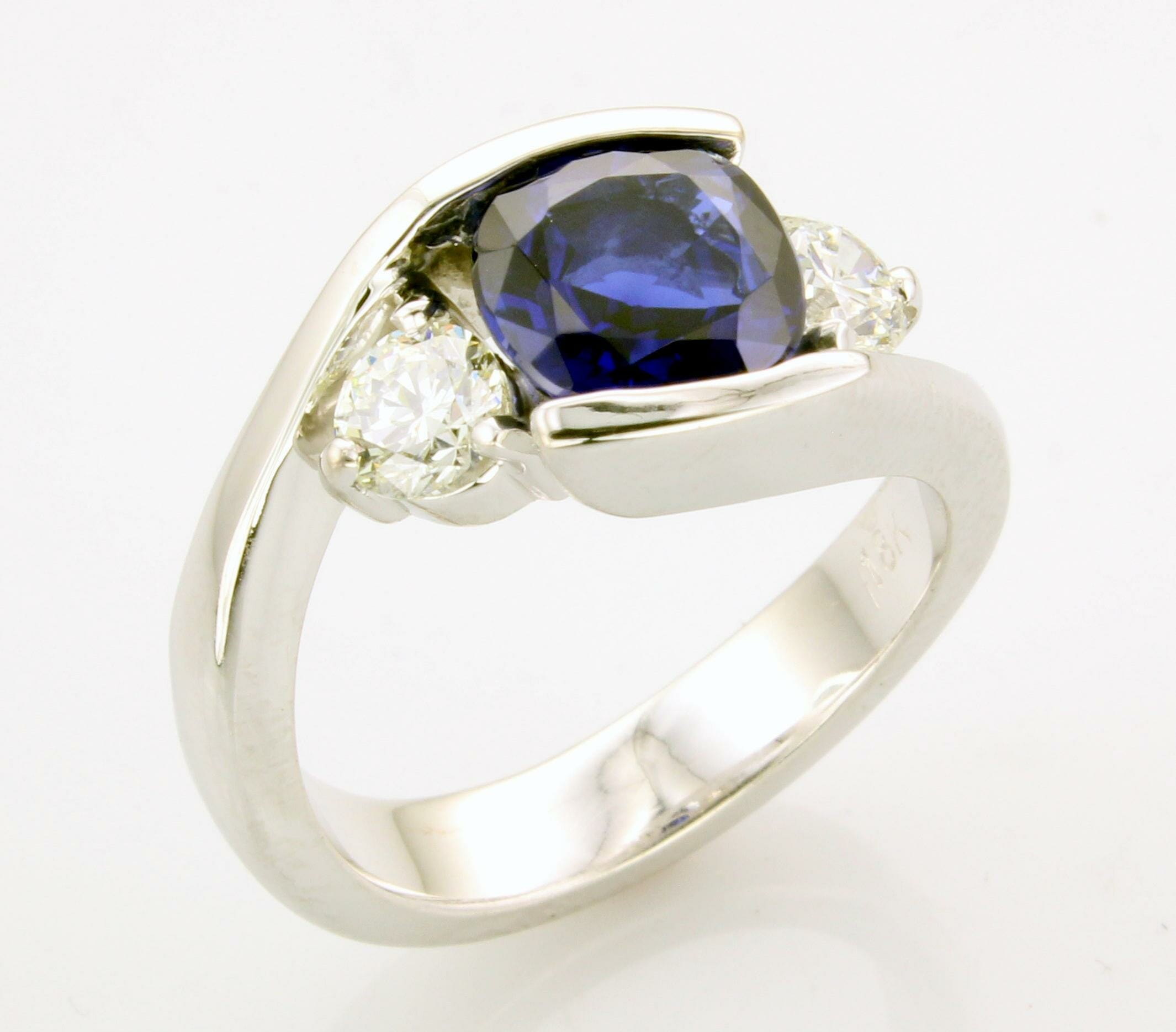 Sapphire diamond engagement ring with side diamonds