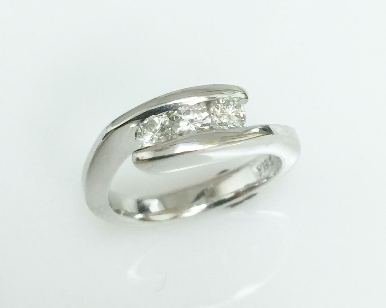 Three stone bypass diamond ring
