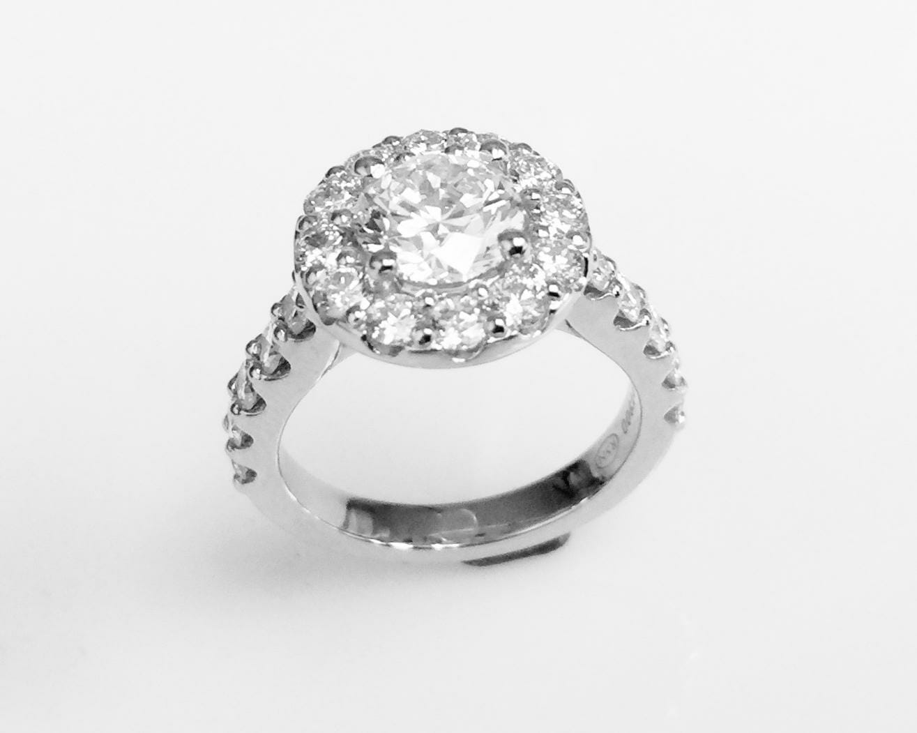 Diamond halo engagement ring with scallop shank