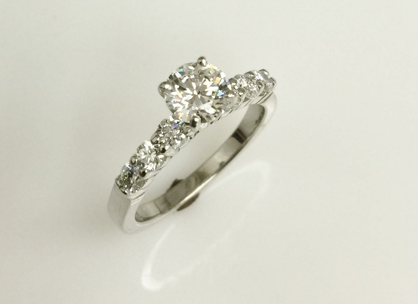 joni solitaire diamond engagement ring with side diamonds