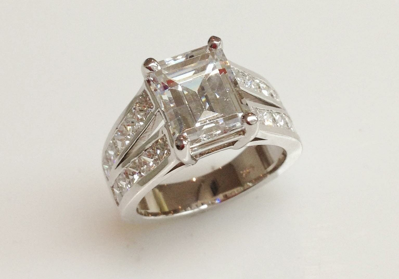 emerald cut diamond engagement ring with split shank