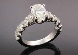 Linda pear diamond ring with side stones