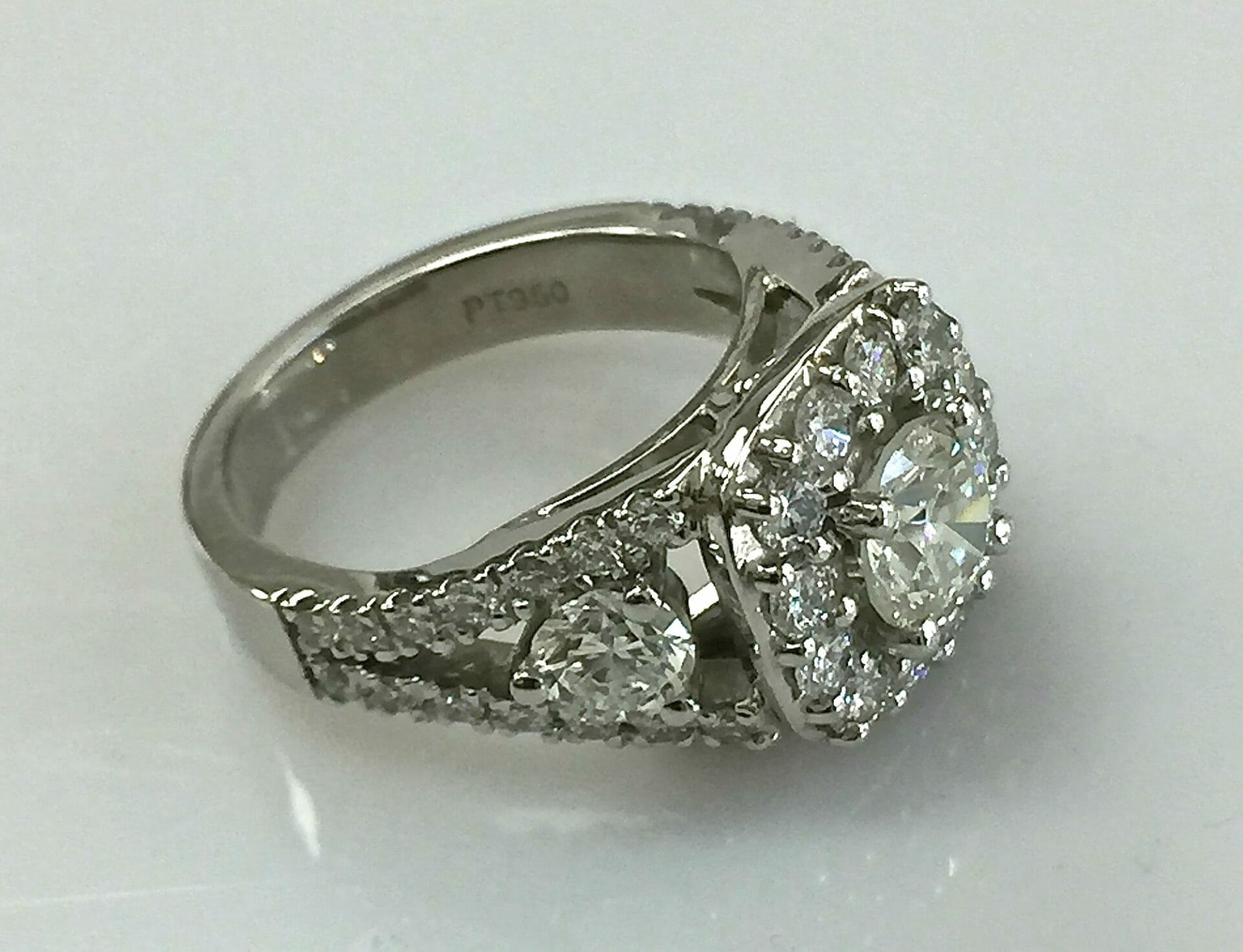 side view Regina split shank diamond halo ring