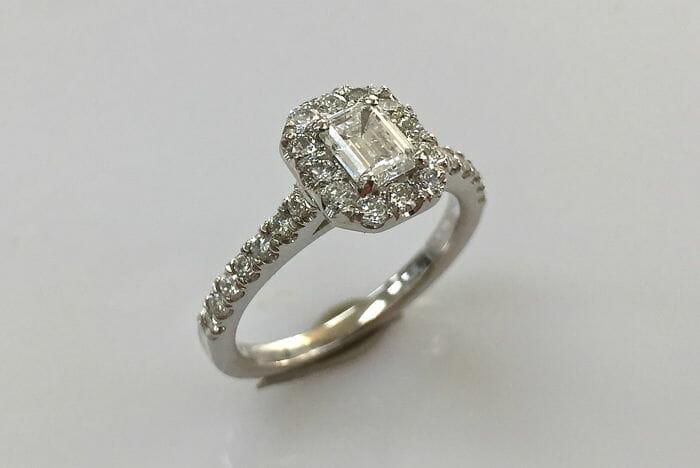 christy emerald cut diamond halo ring
