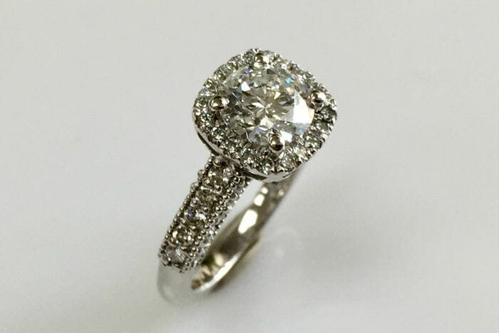 maria 18k white gold halo diamond ring