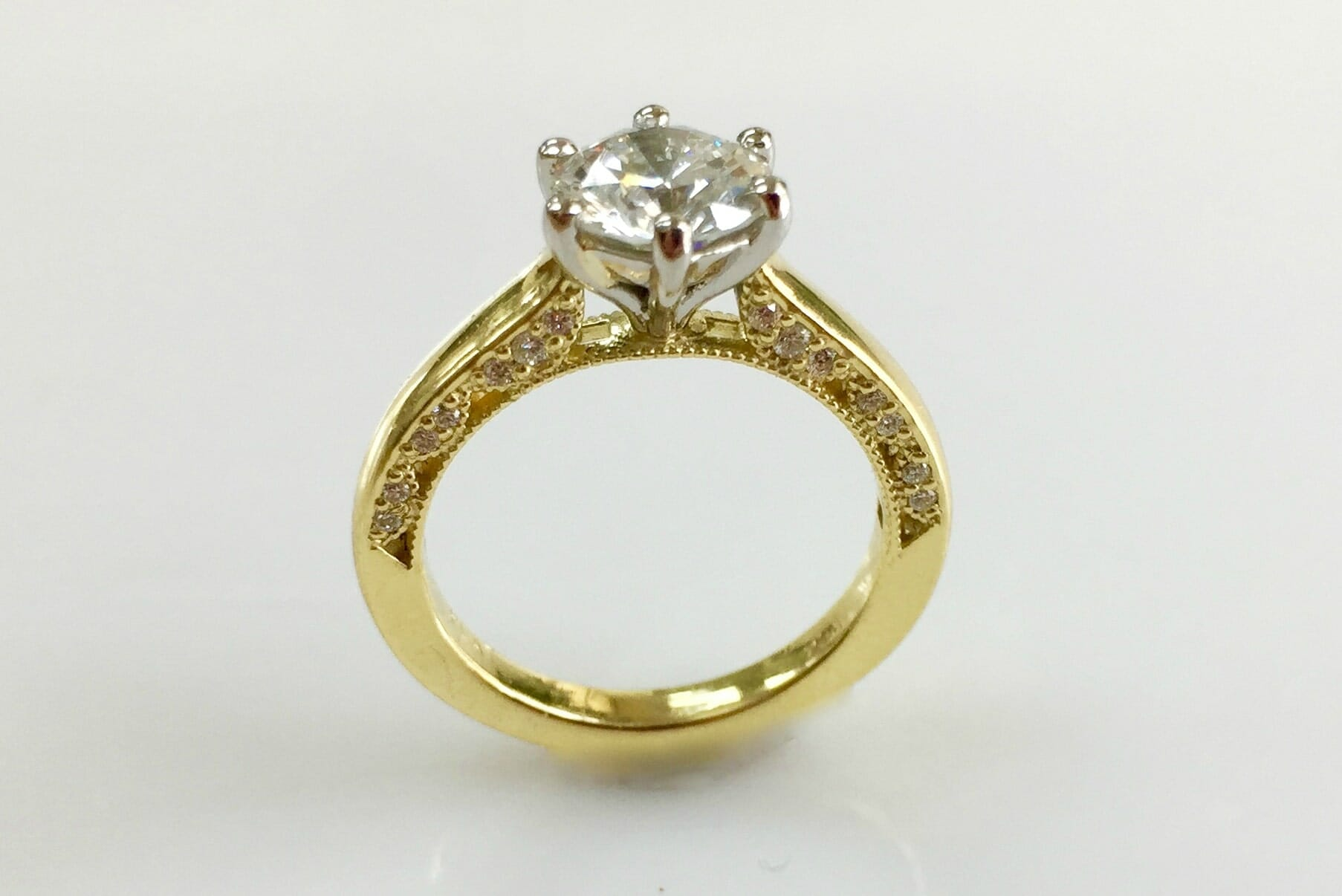 platinum and yellow gold diamond ring with side diamond trim front view