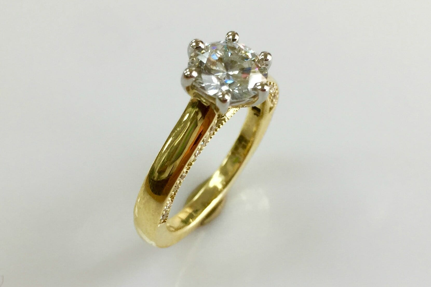 platinum yellow gold diamond solitaire ring with side trim top view