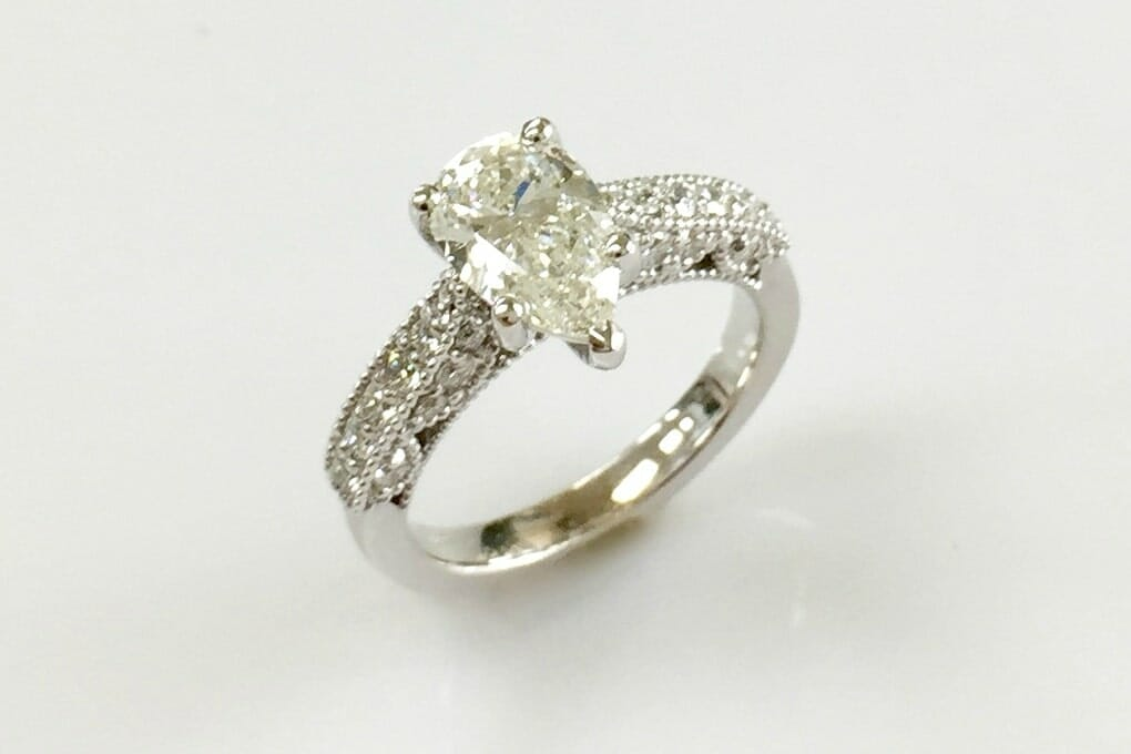 18k white gold pear shaped diamond engagement ring
