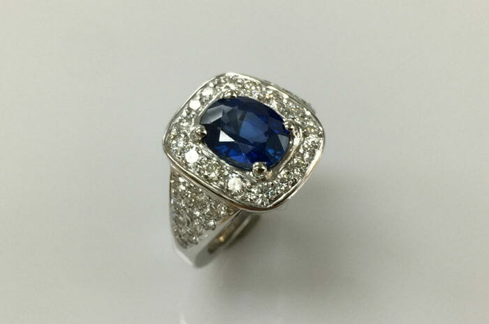 halo diamond and blue sapphire ring